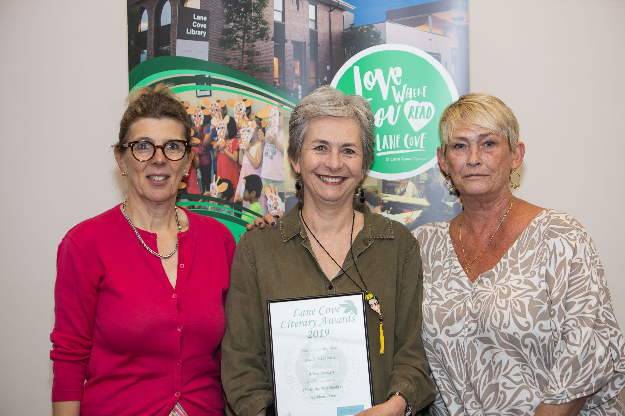 Burns Bay Bookery operators with winner of Resident Prize, Alison Stewart.jpg